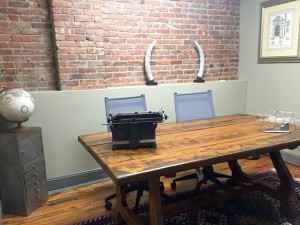 Empty desk with two chairs