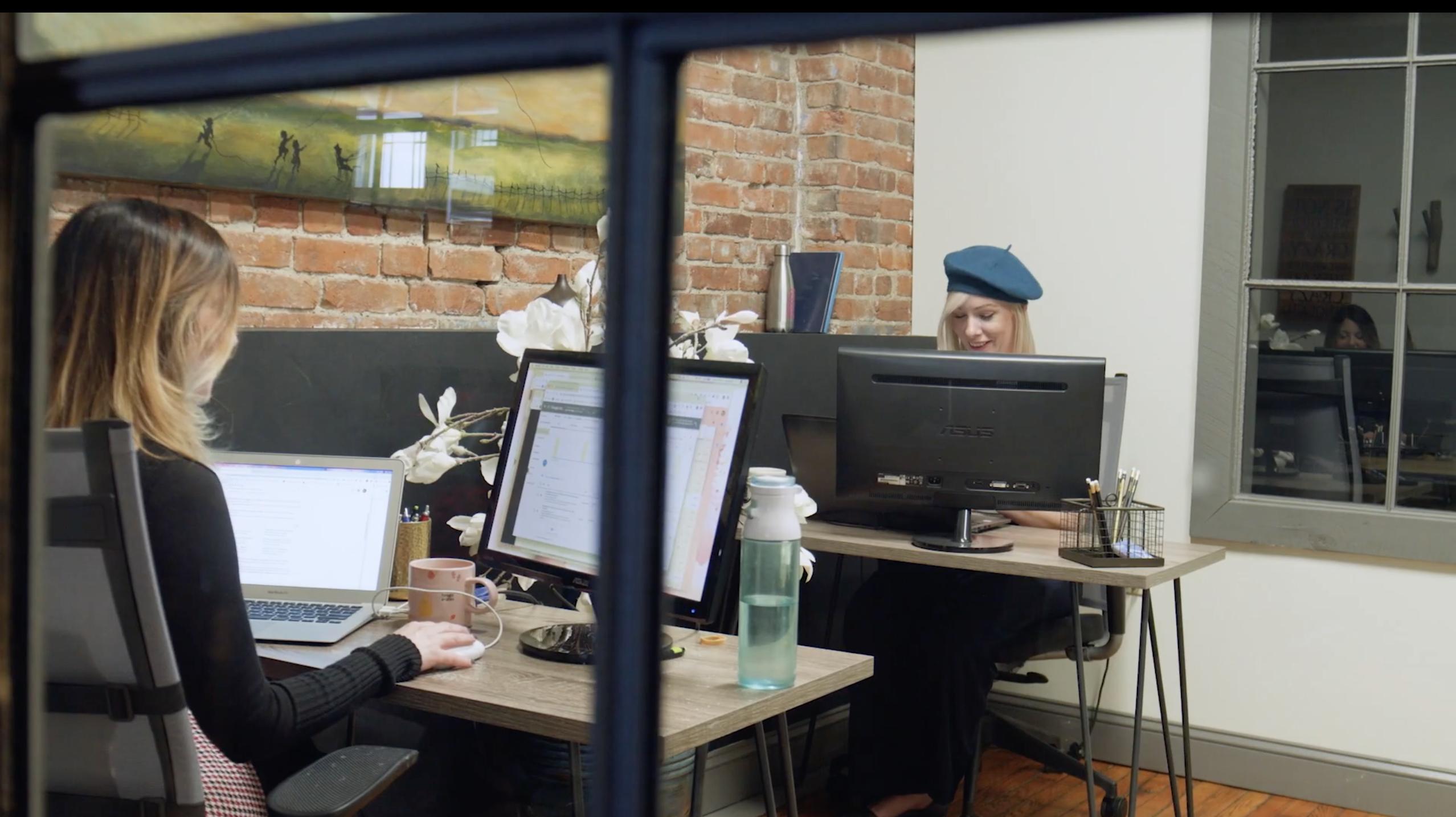 2 women ask desks