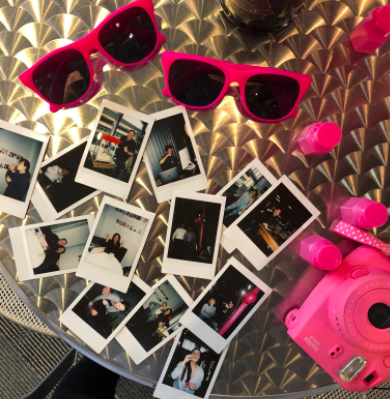 Party Favors and Polaroids on table