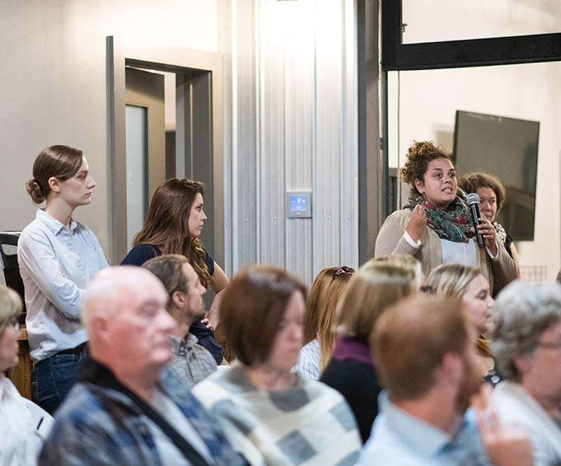 Women with microphone ask question during presentation